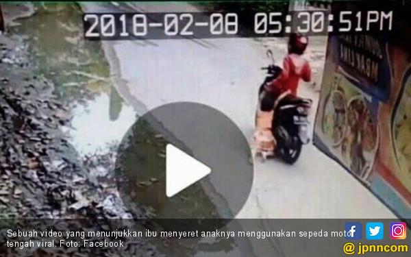 Ibu Seret Anak Ratusan Meter Menggunakan Sepeda Motor - JPNN.COM