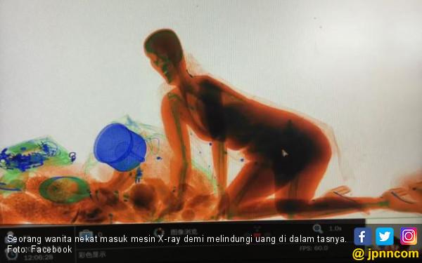 Takut Duit Hilang, Wanita Ini Ikuti Tasnya Masuk Mesin X-ray - JPNN.COM