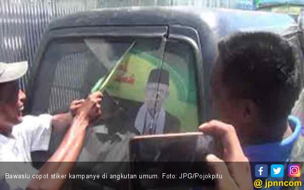 Bawaslu Copot Stiker Kampanye Jokowi - Ma'ruf di Angkot - JPNN.COM