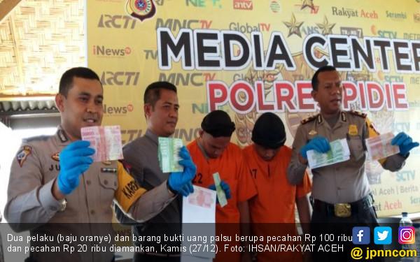 2 Pelaku Pencetak Uang Palsu di Bandar Baru Ditangkap Polisi - JPNN.COM