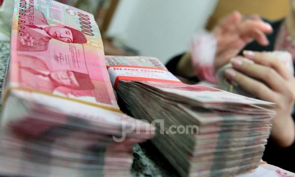 Rupiah Ditutup Menguat di Tengah Kegalauan Pasar Menunggu Hasil Pilpres AS - JPNN.com