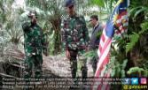 Bendera Malaysia Dikibarkan Melewati Patok Batas - JPNN.COM