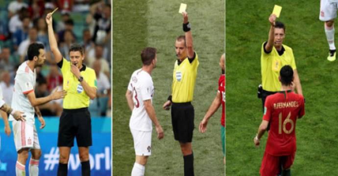 Tiga pemain Iberia, (kiri ke kanan) Sergio Busquets (Spanyol), Adrien Silva (Portugal) dan Bruno Fernandes (Portugal) mendapat kartu kuning di Piala Dunia 2018. Foto: marca